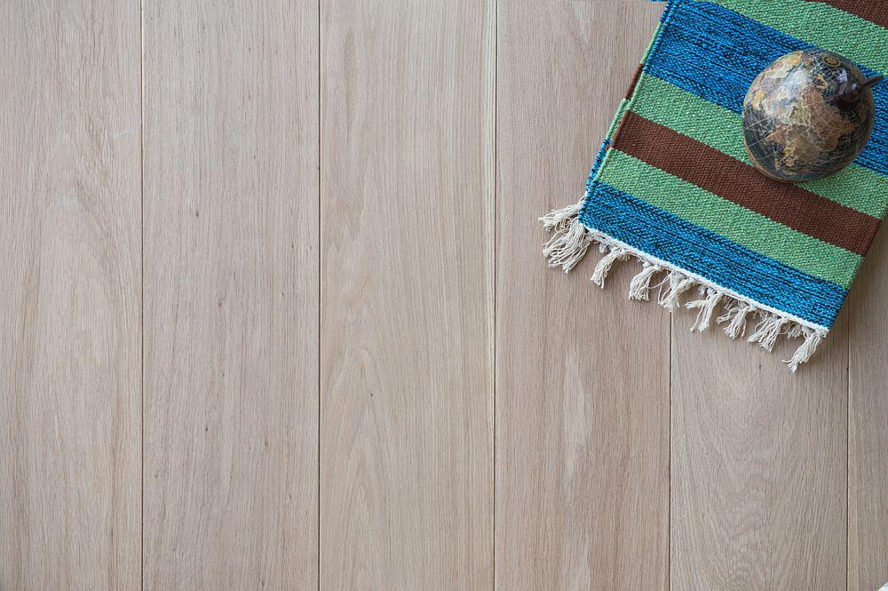 Vloer 4.1. Kleurloos geoliede eikenhouten vloer - Riga Vloeren Amsterdam